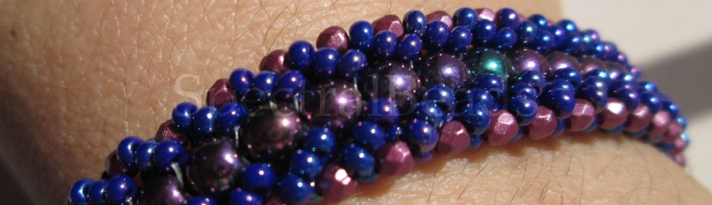 A finished Flat-Spiral bracelet in blue and purple, as it is being worn.